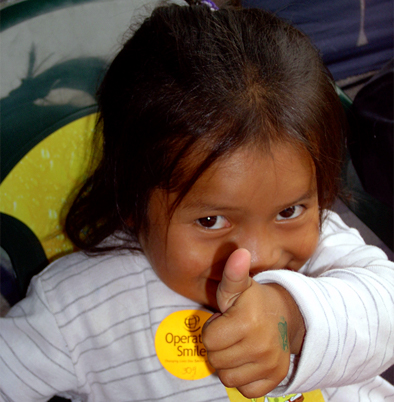 Child giving thumbs up