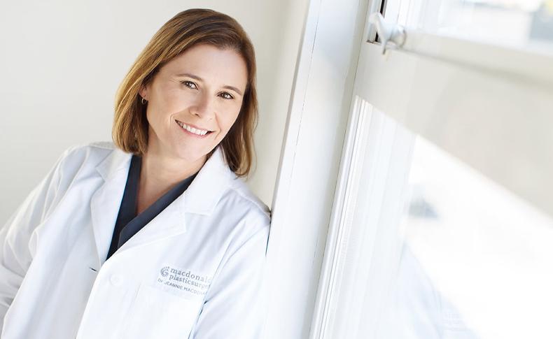 Dr. MacDonald smiling near window
