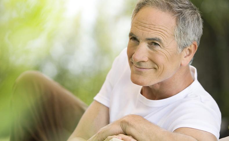 man outside smiling in white shirt